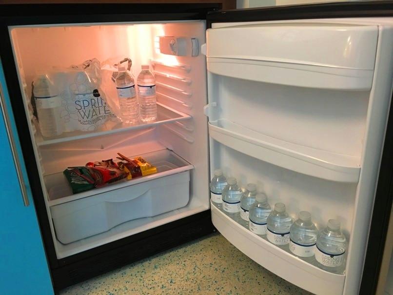 refrigerator in hotel room