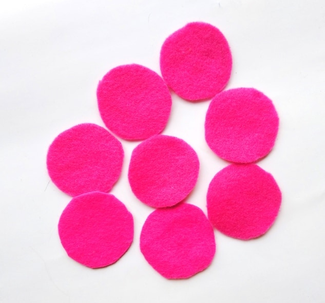 eight pink felt circles