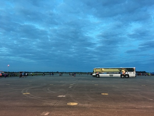 bus on runway at dawn