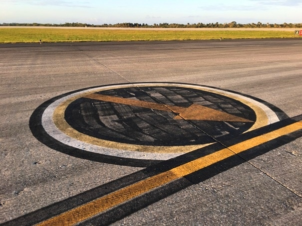 arrow painted on runway