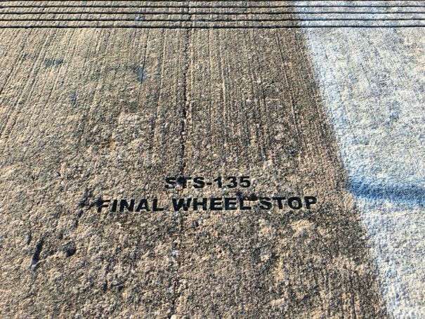 space shuttle runway with engraved words sts-135 final wheel stop