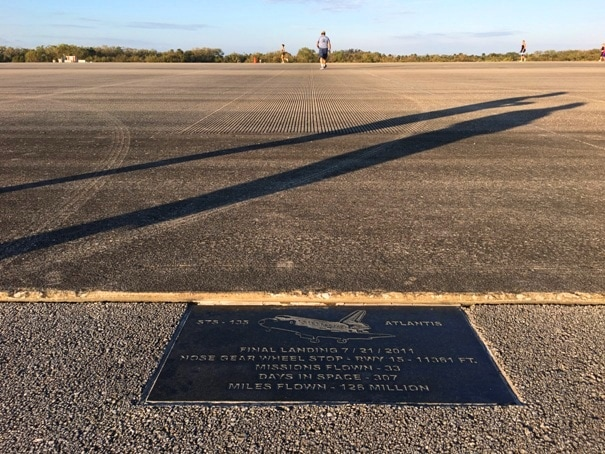 plaque on edge of runway with image of a space shuttle