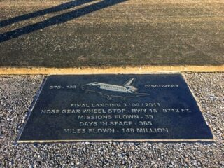 plaque on side of runway with space shuttle