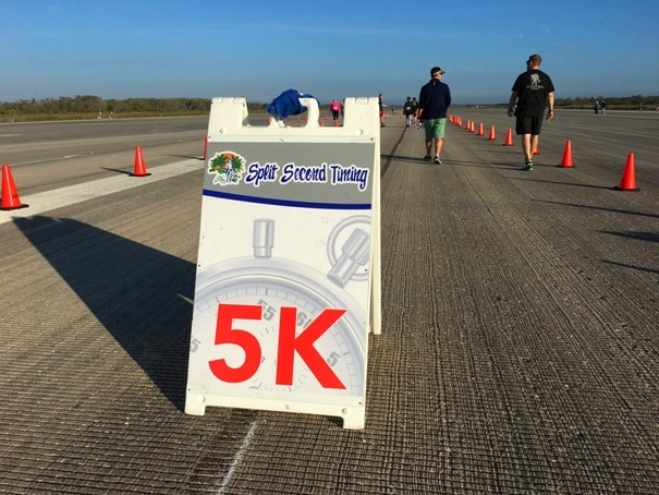 portable sign for 5k race on runway