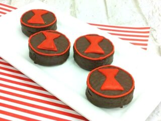 Tray of ding dongs with hourglass shapes on top in red