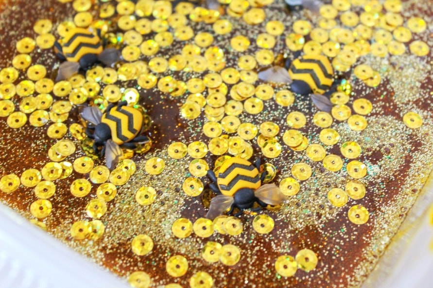 gold sequins glitter plastic honey bees in slime mixture
