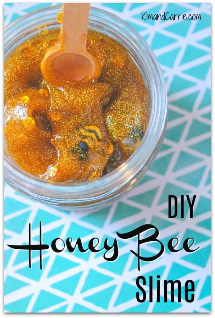 jar of honey colored slime with bumble bees and glitter inside
