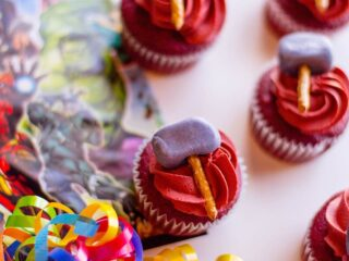 red velvet cupcakes with red frosting and min hammers on top for Thor superhero Avenger