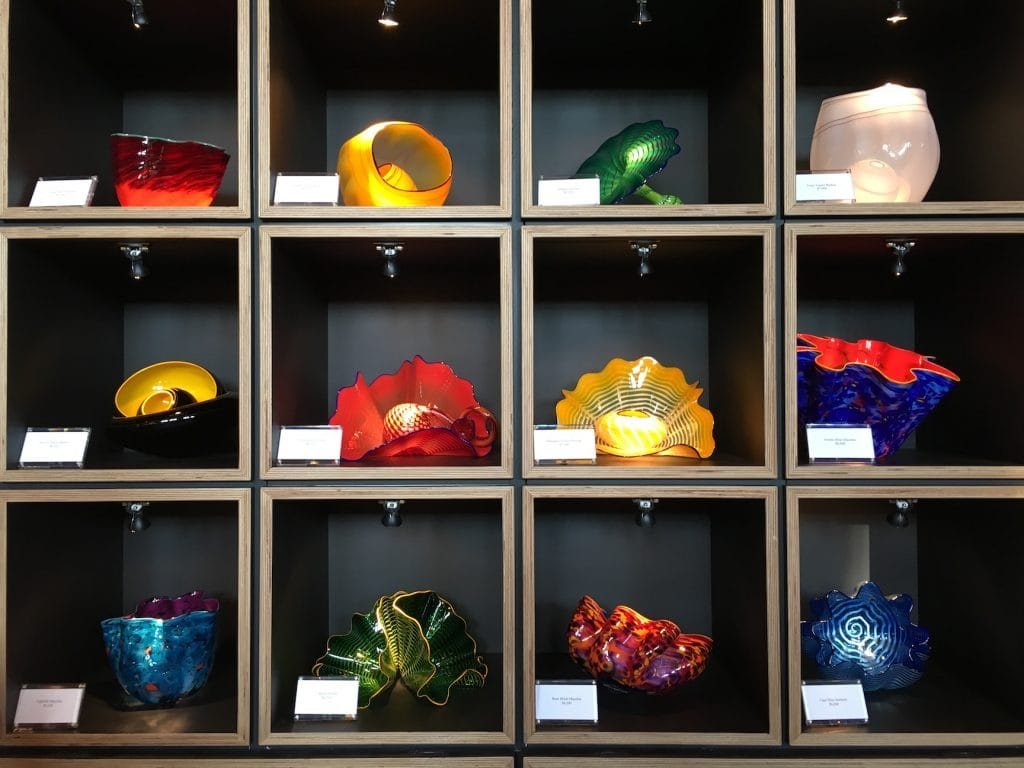 Shelves full of Chihuly Glass sculptures for sale at Biltmore Estate