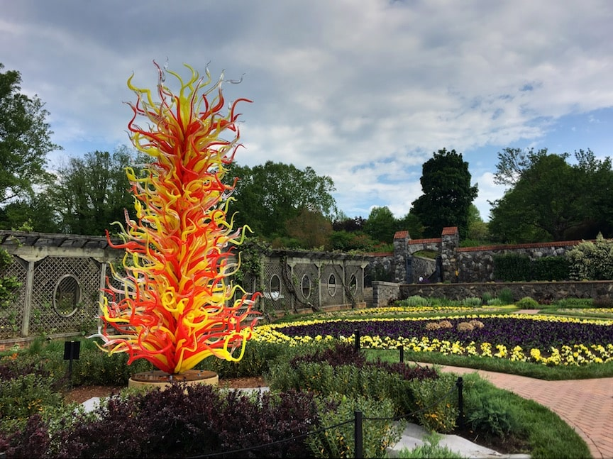 red and yellow glass sculpture in garden at Biltmore House