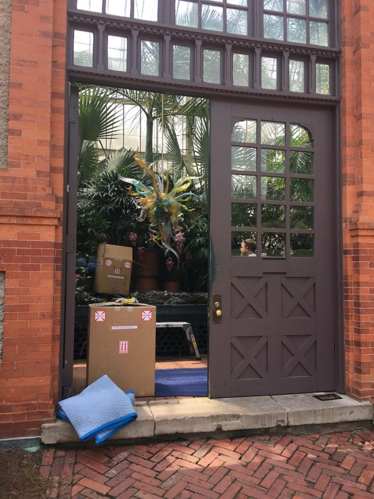 boxes of Chihuly glass pieces in doorway of Biltmore estate conservatory