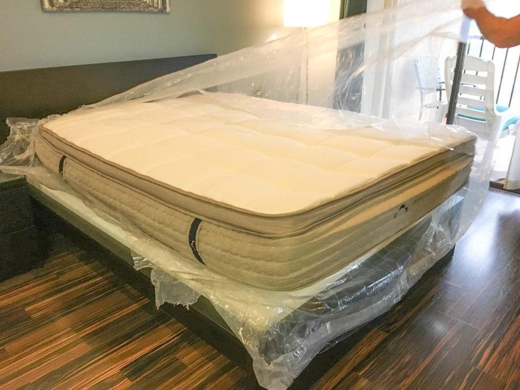 plastic wrapping being removed from dream cloud mattress