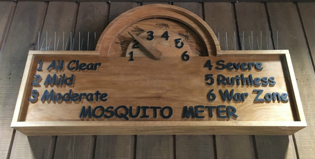 Wooden Mosquito Meter sign measuring how many mosquitoes