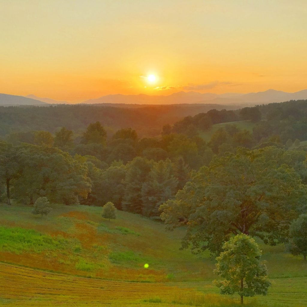 sunset behind the Blue Ridge Mountains at Biltmore Estate