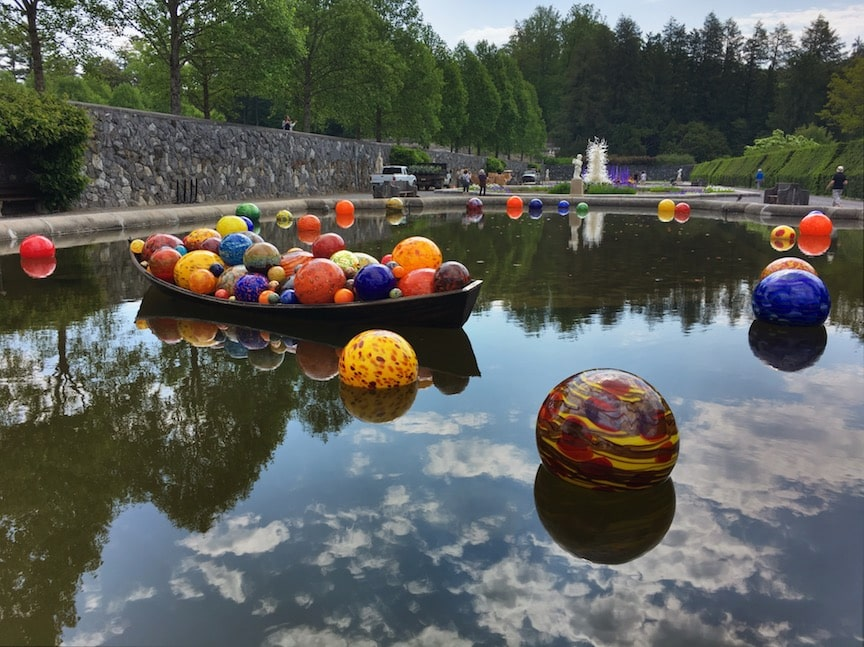 Chihuly glass balls in pond at Biltmore estate
