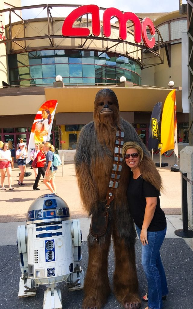 Kim with Chewbaca and r2d2 at Disney springs for Star Wars movie