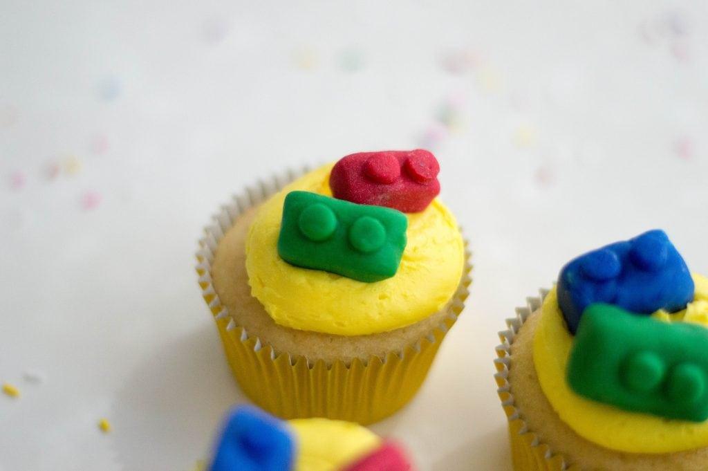homemade edible Legos on top of cupcakes