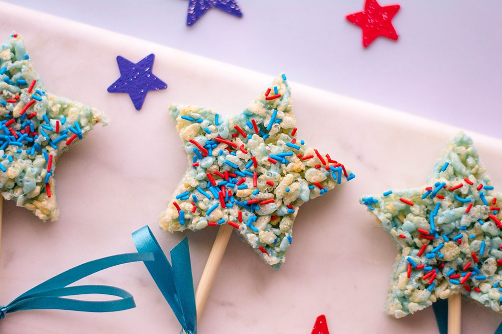 star shape red white and blue rice krispies treat on a stick