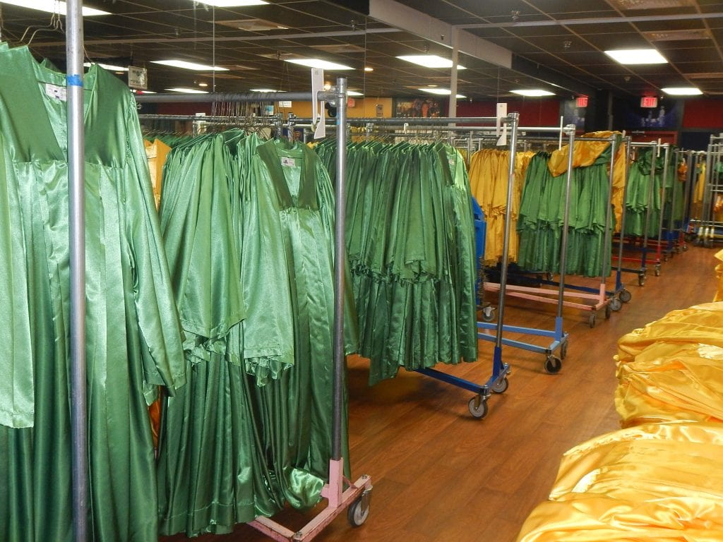 choir robes hanging on clothes racks