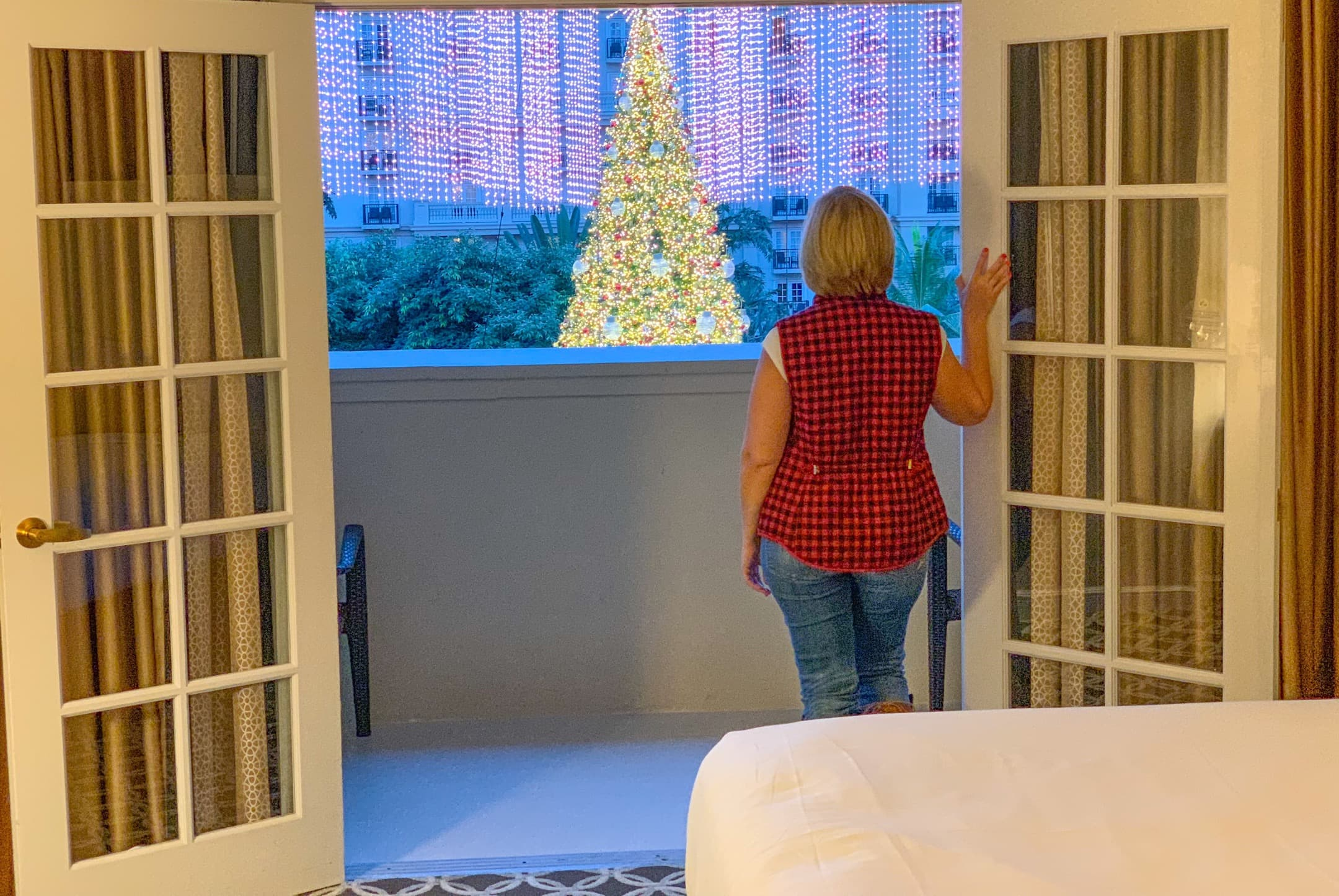 Kim Looking at Christmas Tree from Patio Gaylord Palms