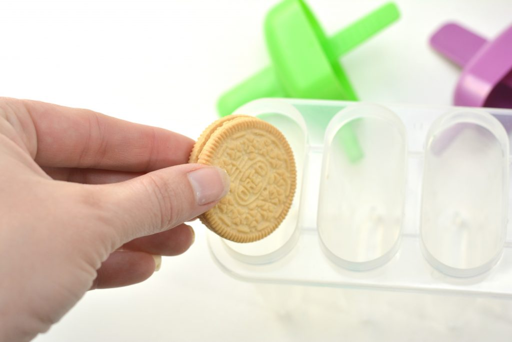 Golden Oreo in a Popsicle Mold for Milk and Cookies Popsicles