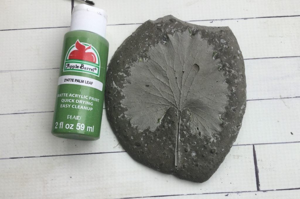 leaf imprint in concrete decorative garden stone with green paint