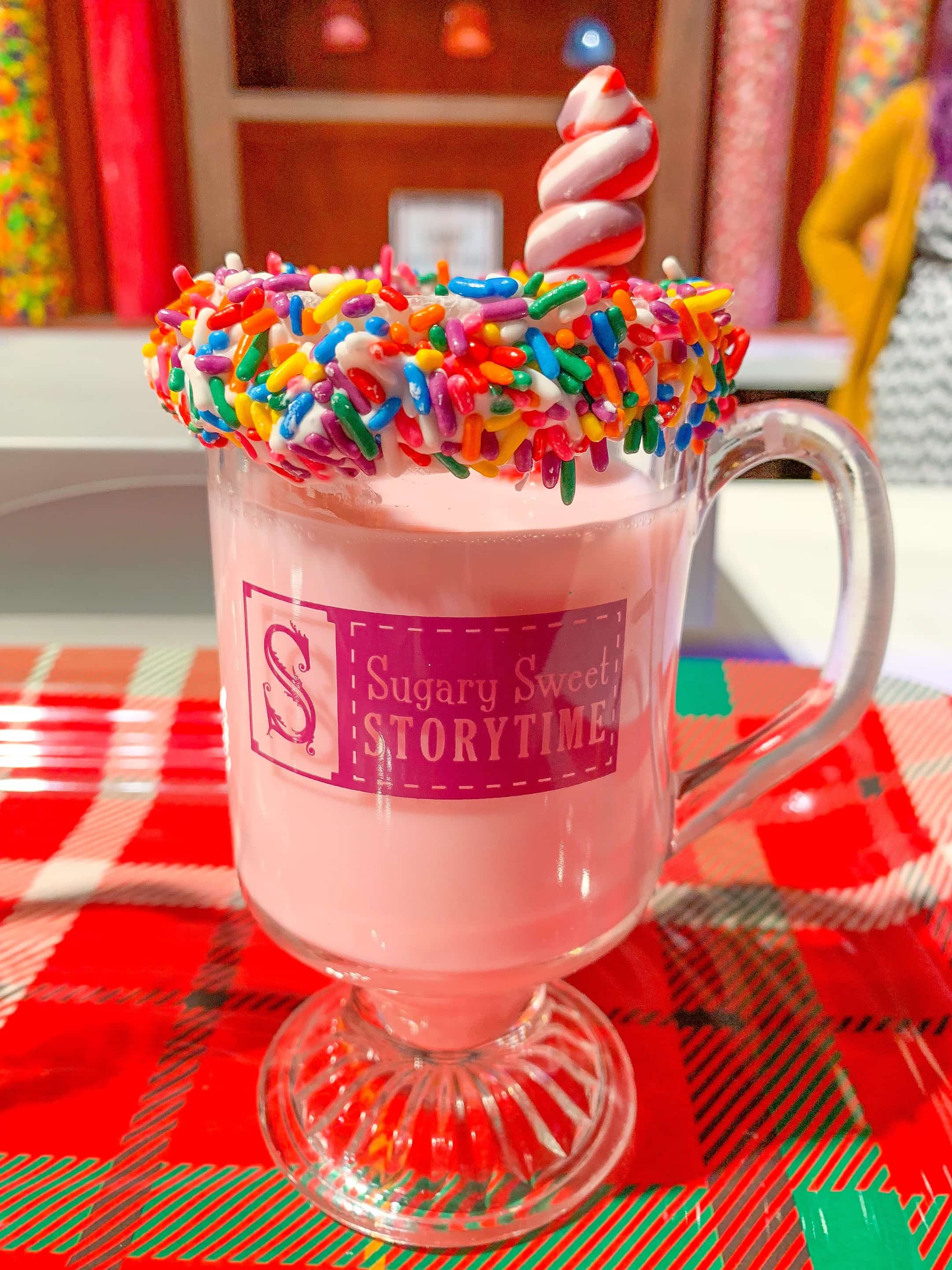 pink hot chocolate in glass mug with sprinkles on rim Gaylord Palms ICE 2018 Orlando