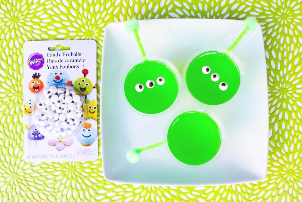 bright green gelatin cups with candy eyeballs