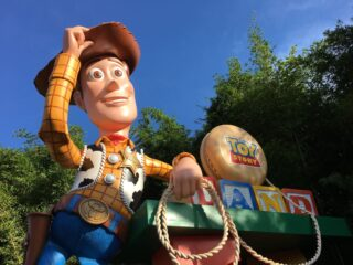 woody at toy story land entrance sign
