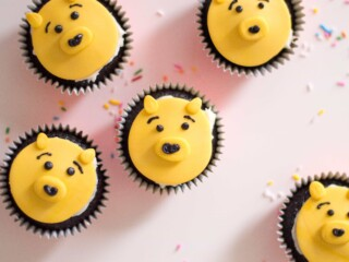 cupcakes with yellow Winnie the pooh faces