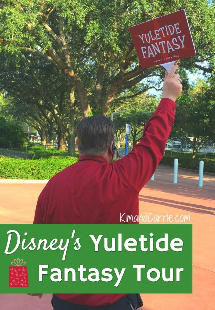 man holding up yuletide fantasy tour sign