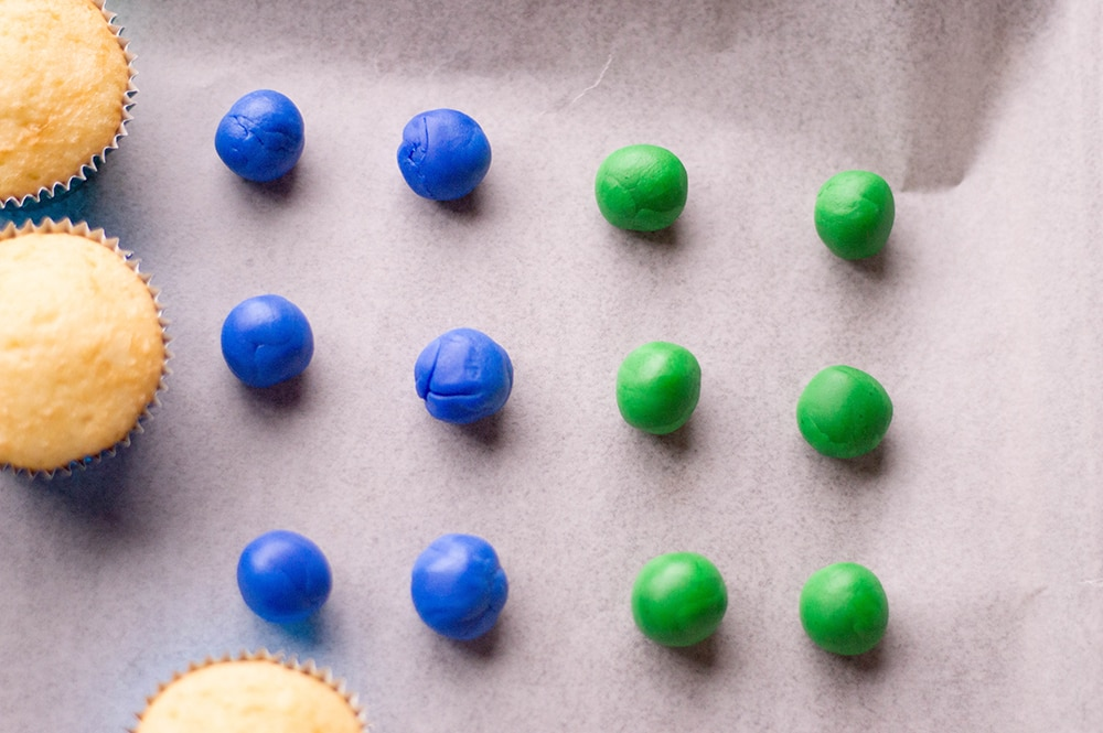 balls of blue and green fondant for edible crayons