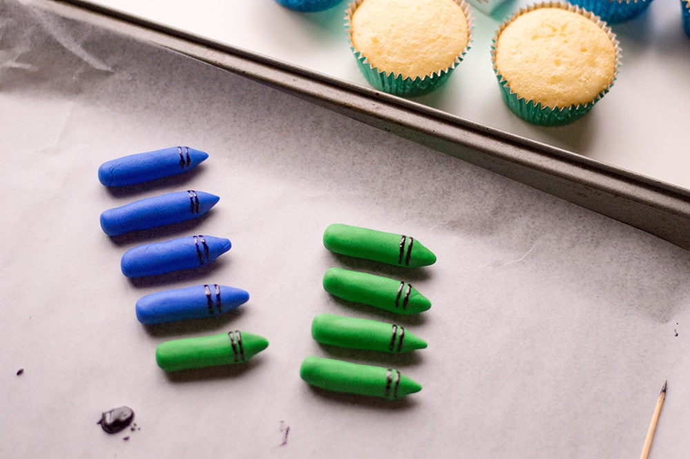 Blue and Green Edible Crayons with Unfrosted Cupcakes