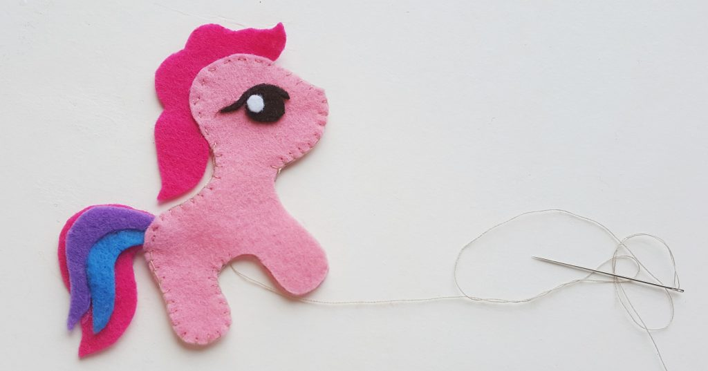 DIY My Little Pony Felt Craft pieces being sewn together with needle and thread