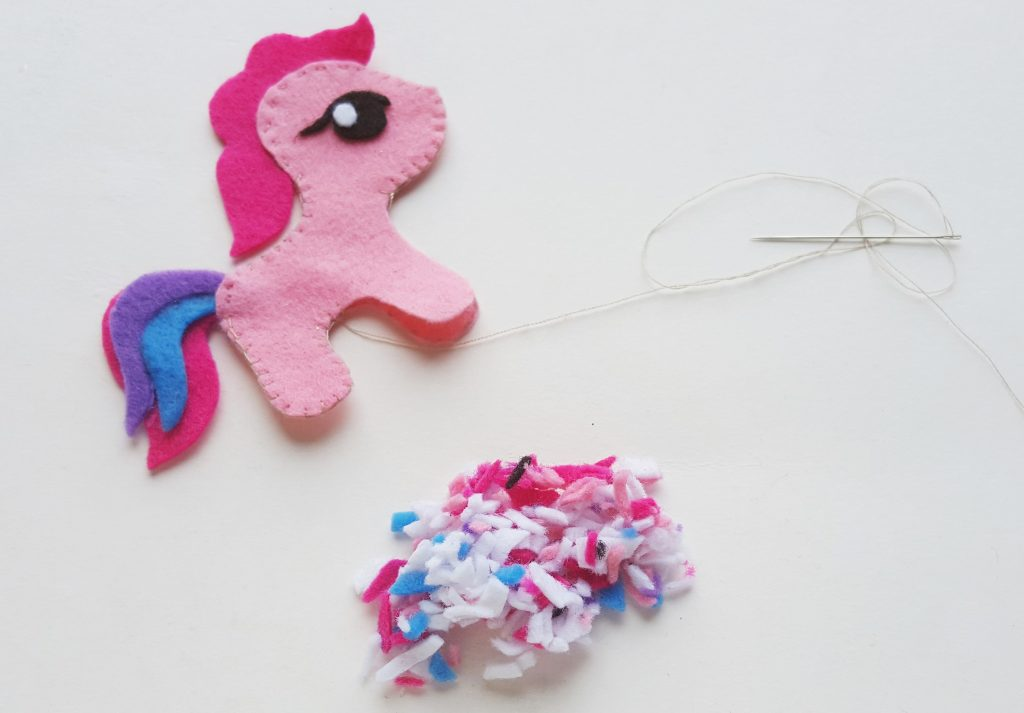DIY My Little Pony Felt pieces sewn together with a pile of tiny felt scraps to use as stuffing