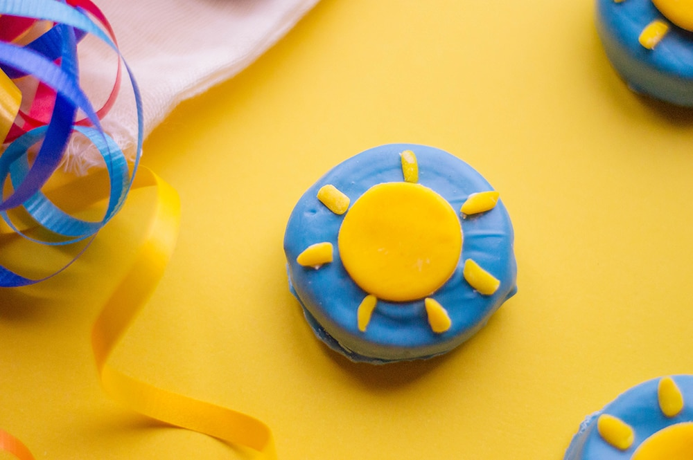 blue cookie with yellow sunshine on top from fondant