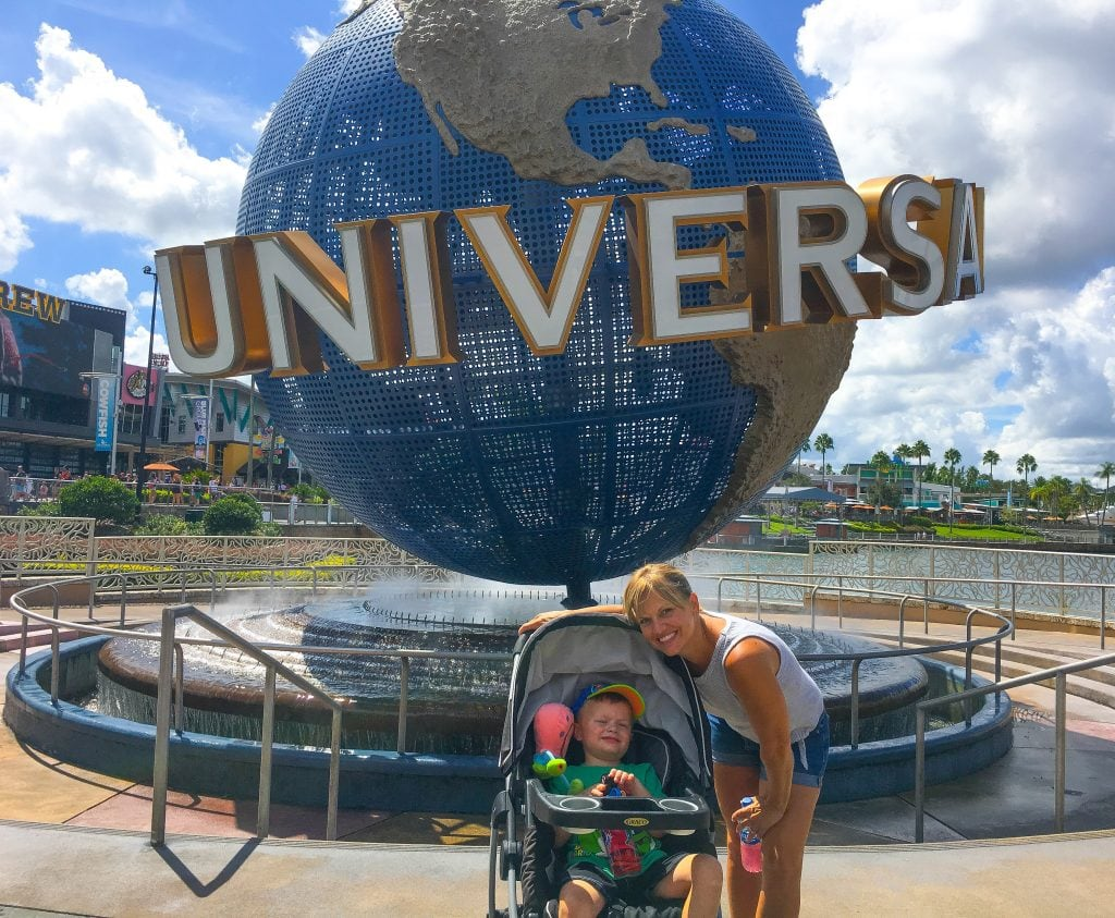 mother and daughter in front of Universal Studios Orlando sign