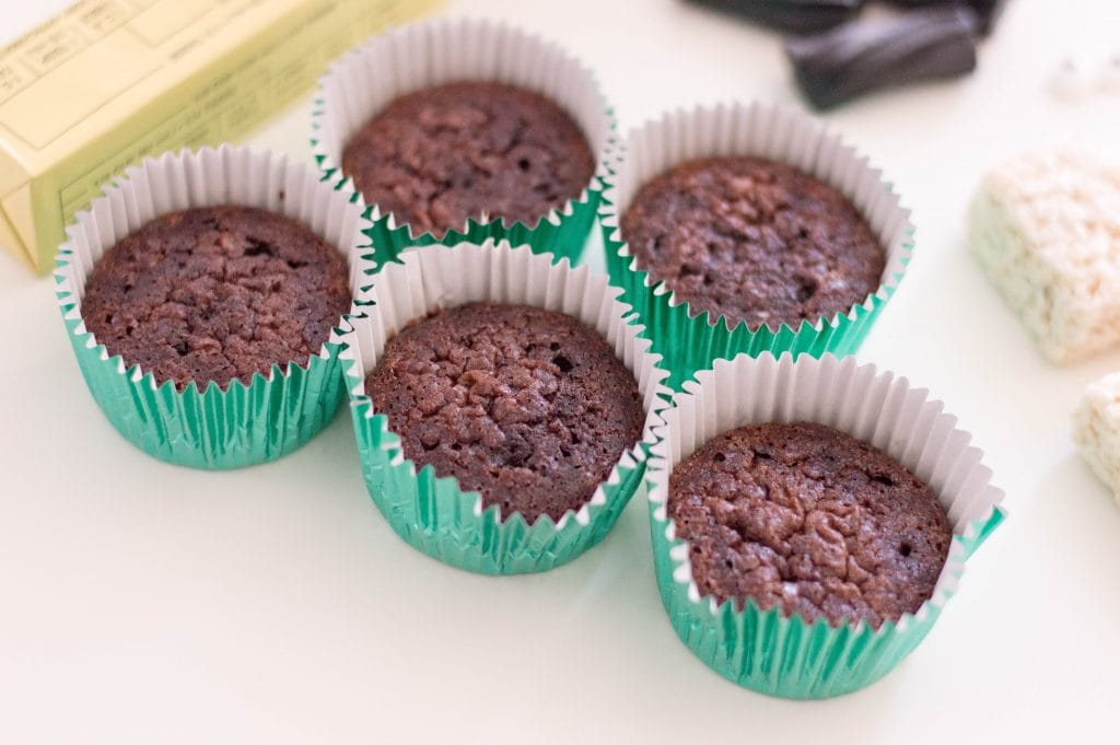 chocolate cupcakes without icing in green baking cups
