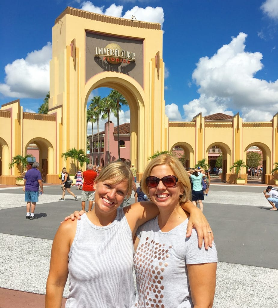 sisters in front of Universal Studios Orlando theme park gate