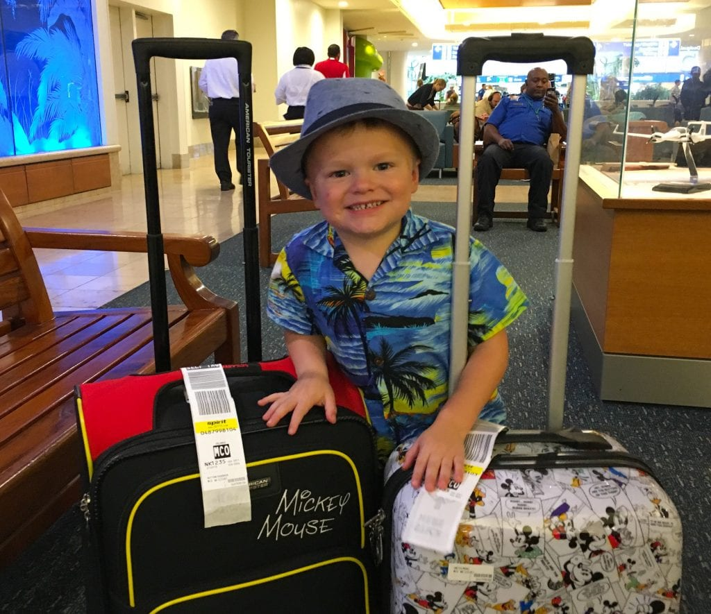 boy with two suitcases