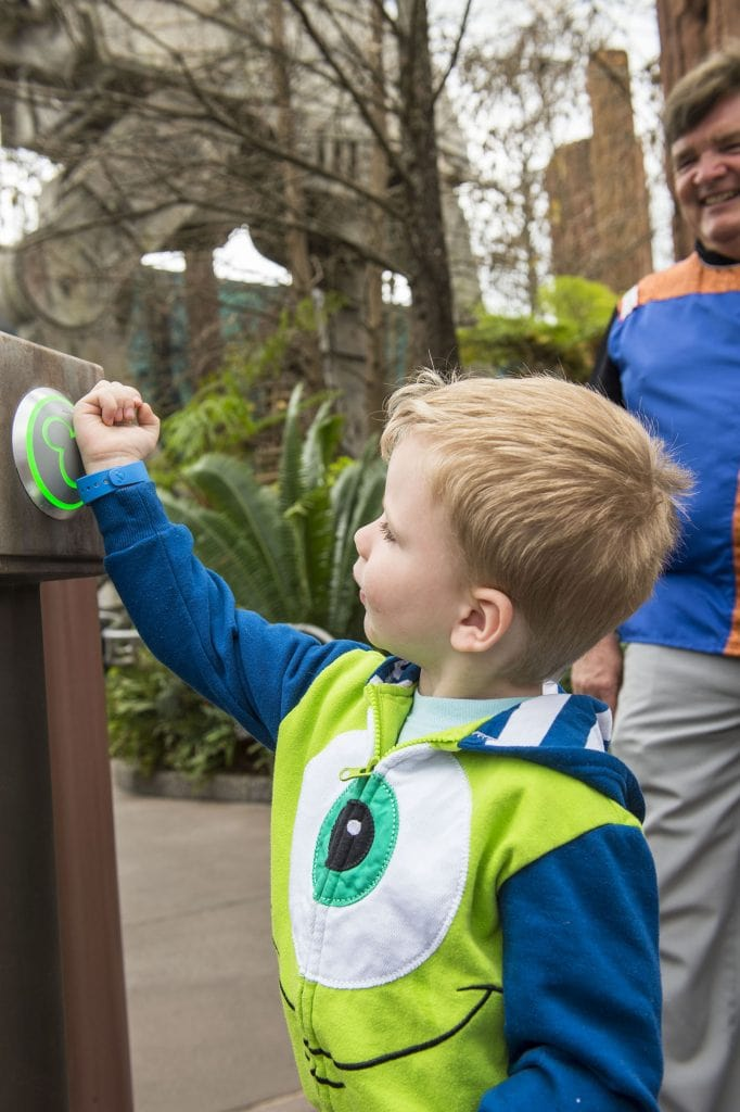 Boy Dressed in Monsters Costume using Disney World MagicBands