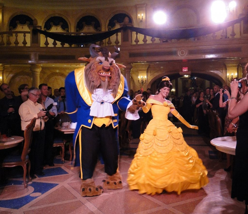 Belle and Beast dancing inside Be our Guest Restaurant Magic Kingdom