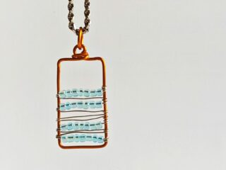 copper wire pendant with turquoise glass beads
