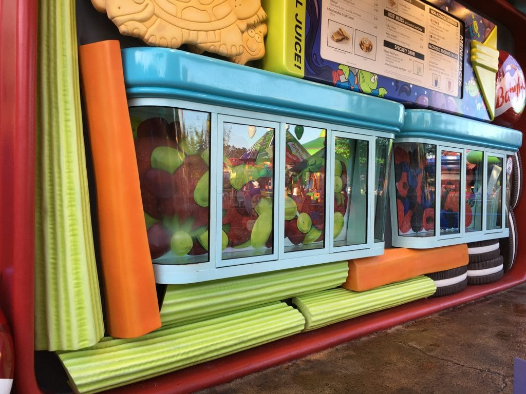 large celery and carrot sticks underneath pick up windows at Disney Toy Story Land Quick Service Restaurant