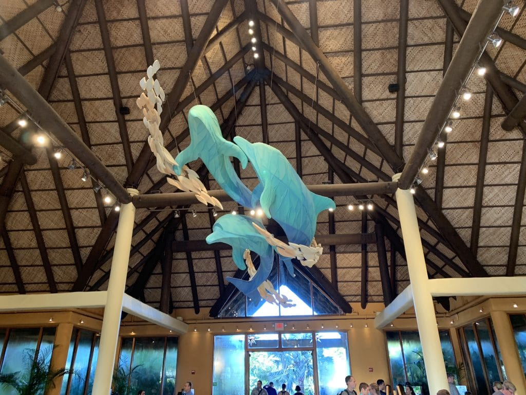 dolphin sculptures hanging from ceiling in entrance to Discovery Cove in Orlando Florida