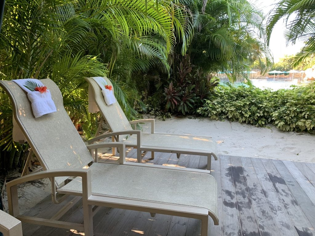 lounge chairs in sand in private cabana at Discovery Cove Orlando
