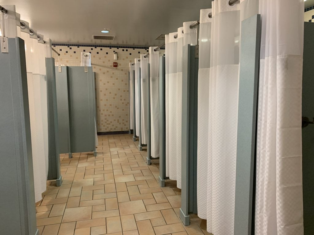 Shower stalls in bathroom Discovery Cove