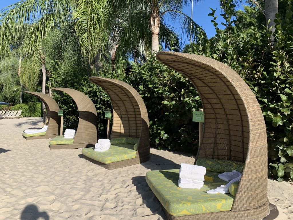 Lounge chairs with shade on the beach at Discovery Cove Orlando Florida