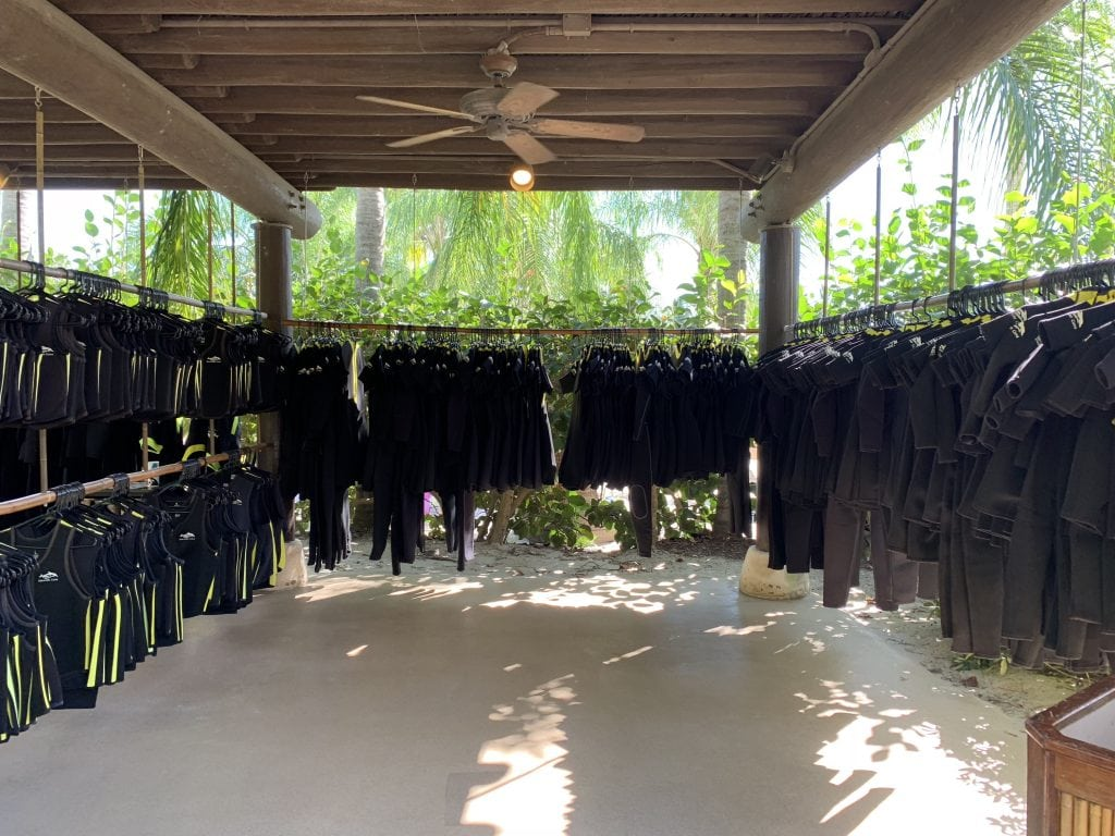 wet suits hanging on racks at Discovery Cove Orlando FL