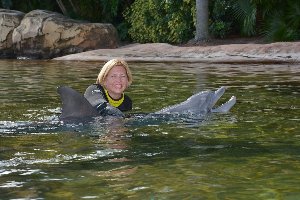 woman hugging dolphin Discovery Cove Orlando Florida